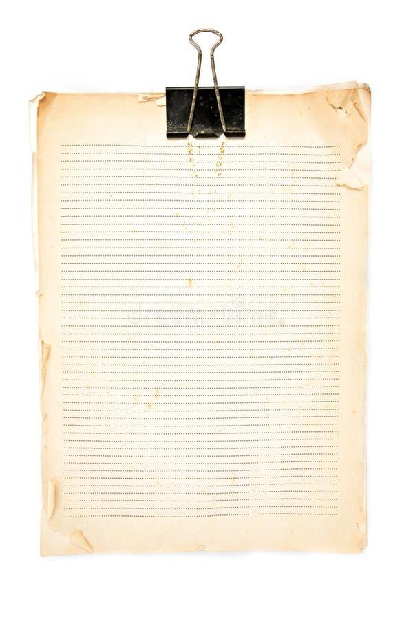 Vecchia nota di carta e clip nera fotografia stock