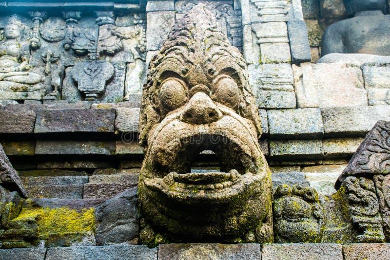 Vecchia parete antica del tempio buddista Borobudur complesso, Yogyakarta, Jawa, Indonesia immagine stock