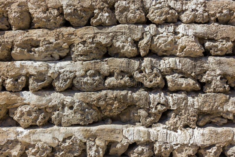 Vecchia parete araba di pietra, struttura architettonica regolare immagine stock libera da diritti