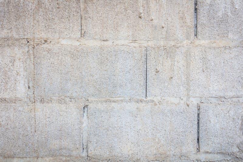 Vecchia parete del blocco in calcestruzzo fotografia stock