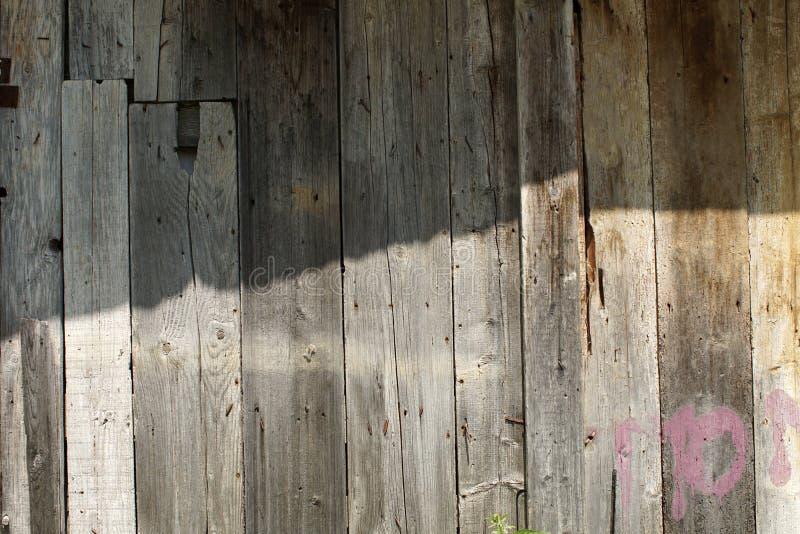 Vecchia parete di legno della plancia fotografie stock