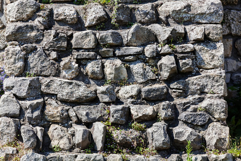 Vecchia parete di pietra immagine stock