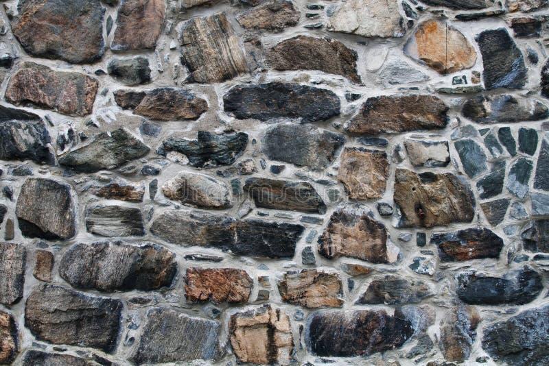 Vecchia parete di pietra. Priorità bassa/struttura di pietra del reticolo fotografia stock