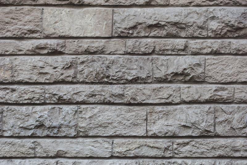 Vecchia parete di pietra spaccata, bella struttura del fondo immagine stock
