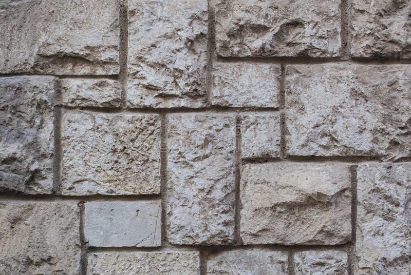 Vecchia parete di pietra spaccata, bella struttura del fondo immagini stock libere da diritti