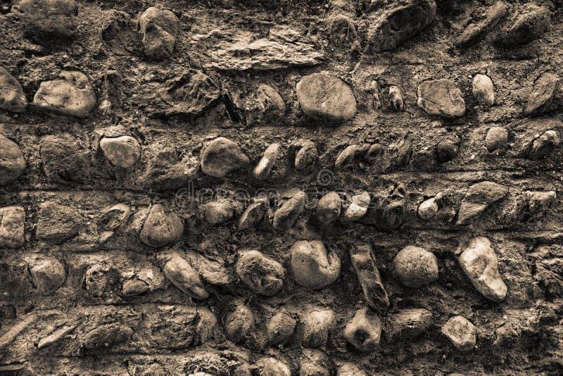 Vecchia parete di pietra, struttura di tecnica di lerciume, superficie ruvida della roccia fotografie stock libere da diritti