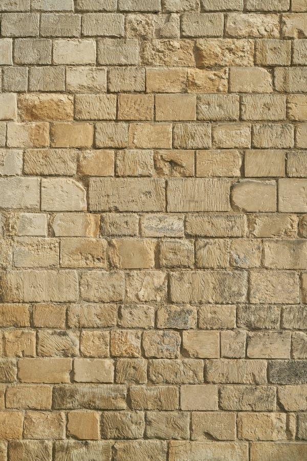 Vecchia parete di pietra di un castello come struttura del fondo fotografia stock