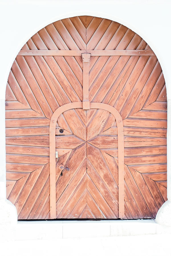 Vecchia porta marrone chiaro di legno fotografia stock