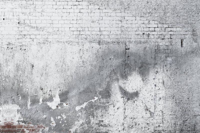 Vecchia priorità bassa concreta incrinata del muro di mattoni illustrazione vettoriale