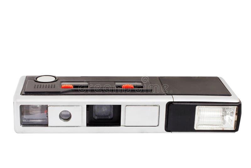 Vecchia retro macchina fotografica della foto della tasca sul film isolato su fondo bianco fotografie stock