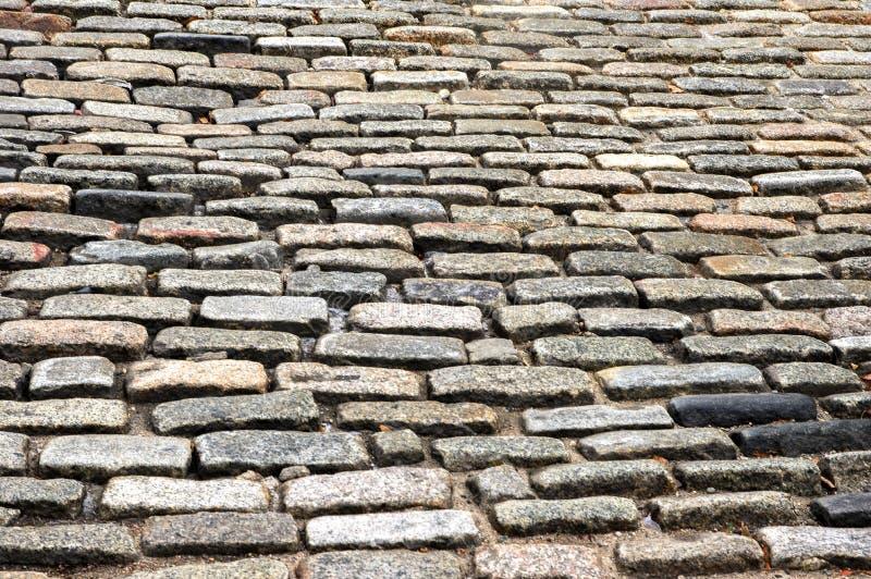 Vecchia retro pavimentazione di strada di pietra immagine stock