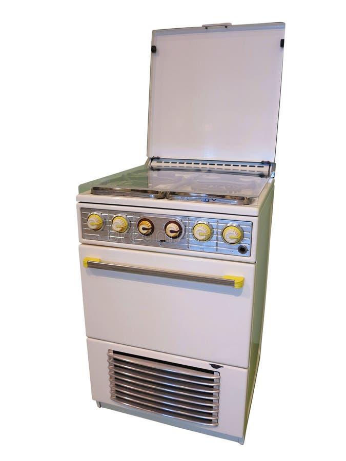 Vecchia retro stufa di gas d'annata bianca della cucina isolata sulla parte posteriore di bianco immagini stock