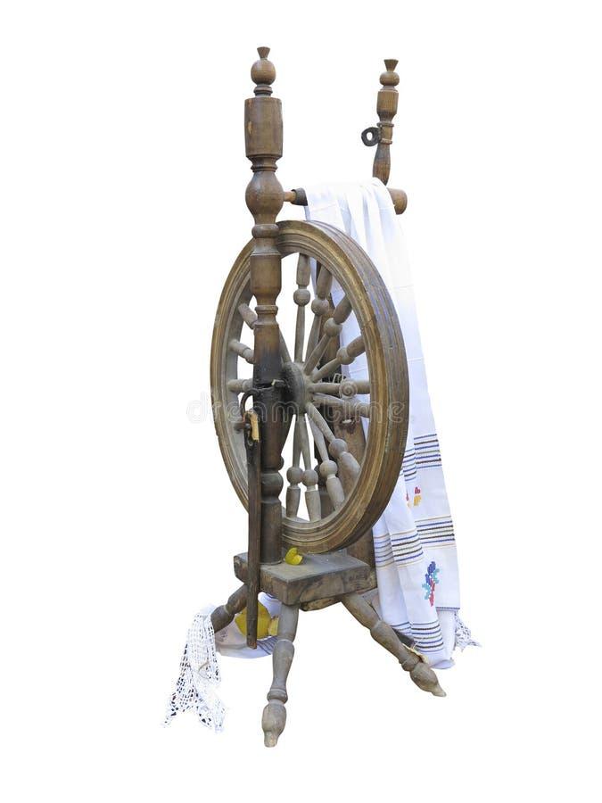 Vecchia rocca di legno manuale della filare-ruota isolata su backg bianco immagini stock libere da diritti