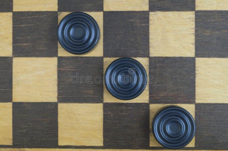 Vecchia scacchiera di legno del fondo immagini stock libere da diritti