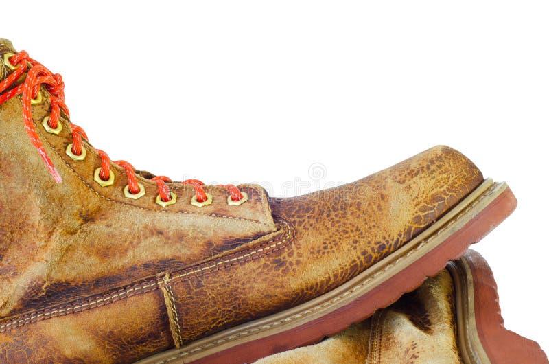 Vecchia scarpa di cuoio isolata su fondo bianco fotografie stock