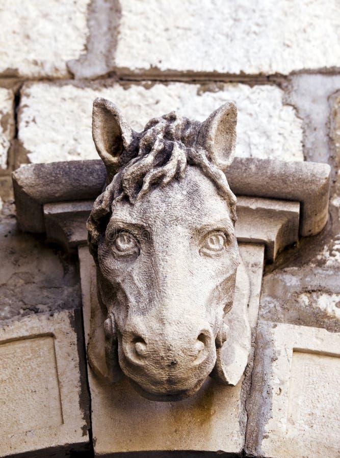 Vecchia scultura della testa di cavallo fotografie stock libere da diritti