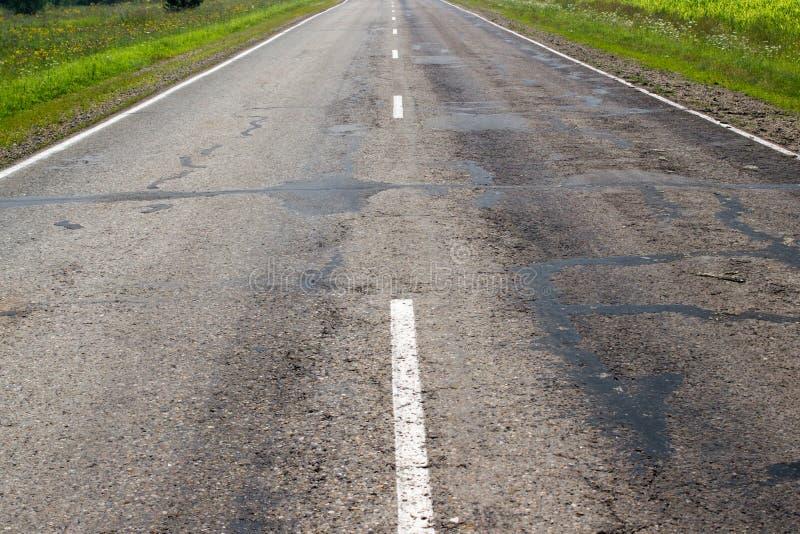 Vecchia strada asfaltata fotografie stock