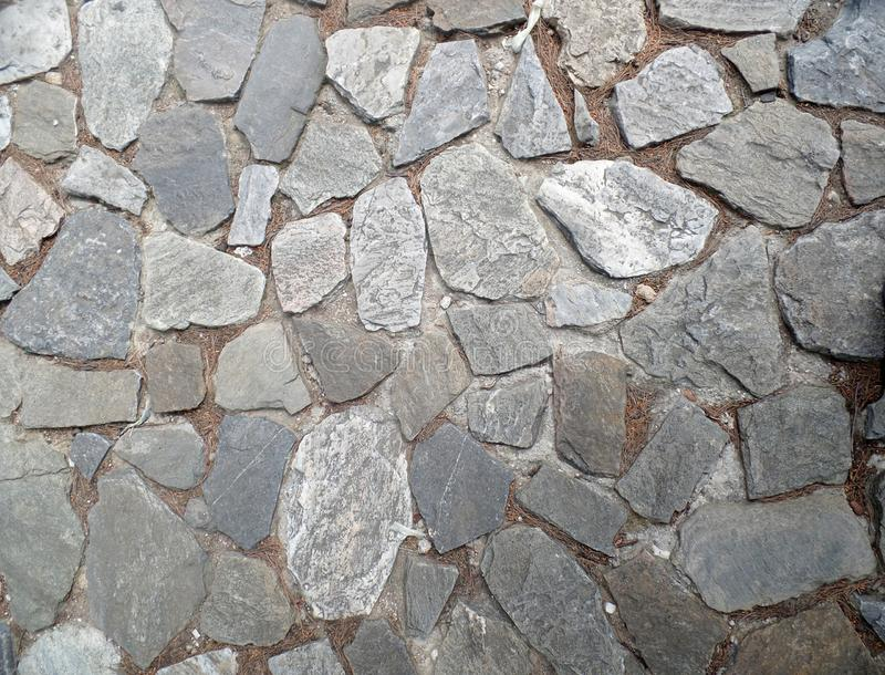 Vecchia strada del villaggio delle pietre grige immagini stock