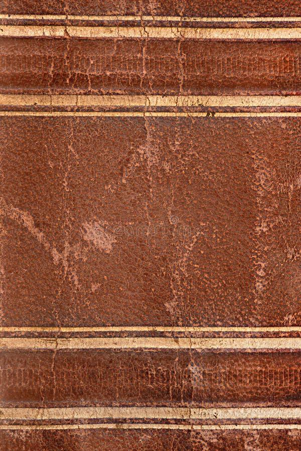 Vecchia struttura di cuoio marrone della spina dorsale del libro immagine stock
