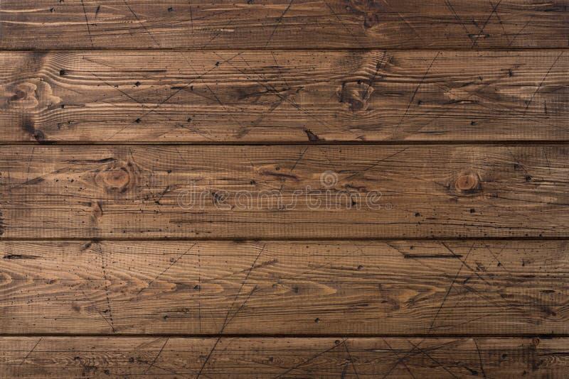 Vecchia struttura di legno marrone stagionata delle plance Fondo di lerciume Fondo di legno marrone graffiato del legname Chiuda  immagini stock libere da diritti