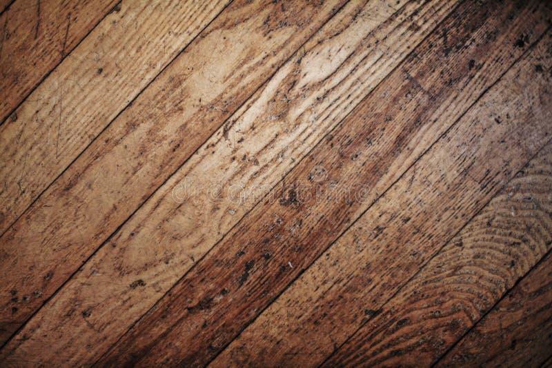 Vecchia struttura di legno naturale graffiata usata del pavimento di parquet fotografia stock