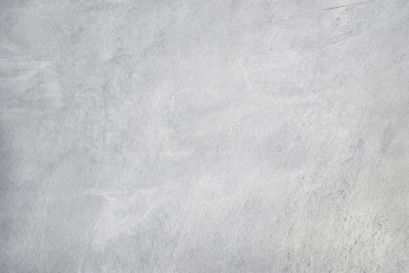 Vecchia struttura grungy, parete grigia bianca del cemento del calcestruzzo di colore con il dettaglio dello stucco ruvido e crep fotografia stock
