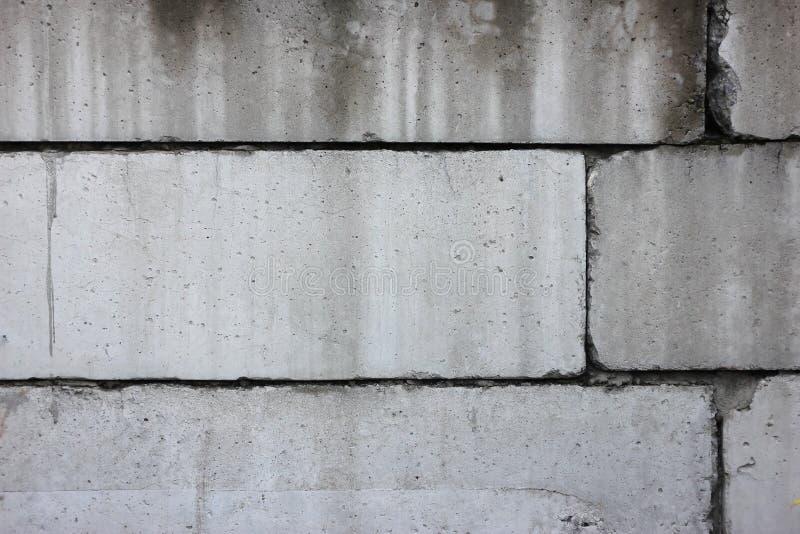 Vecchia struttura nociva reale del fondo della parete del blocco in calcestruzzo fotografia stock