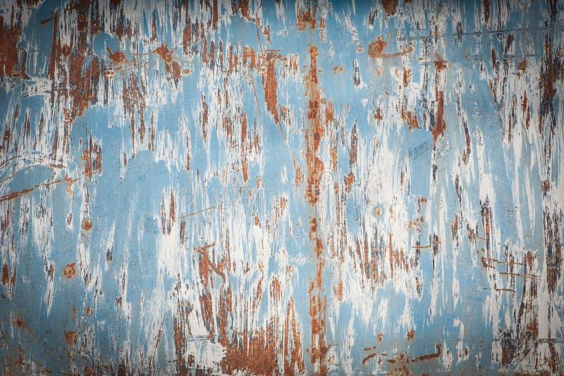 Vecchia superficie di metallo indossata con pittura Struttura arrugginita del metallo Lamina di metallo con ruggine e pittura con fotografia stock libera da diritti