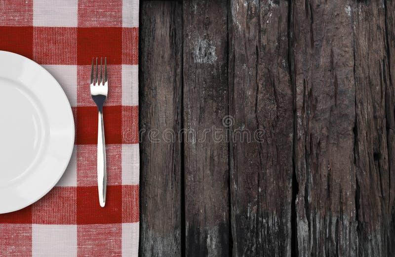Vecchia tavola con il piatto di cena che fissa vista superiore fotografie stock libere da diritti