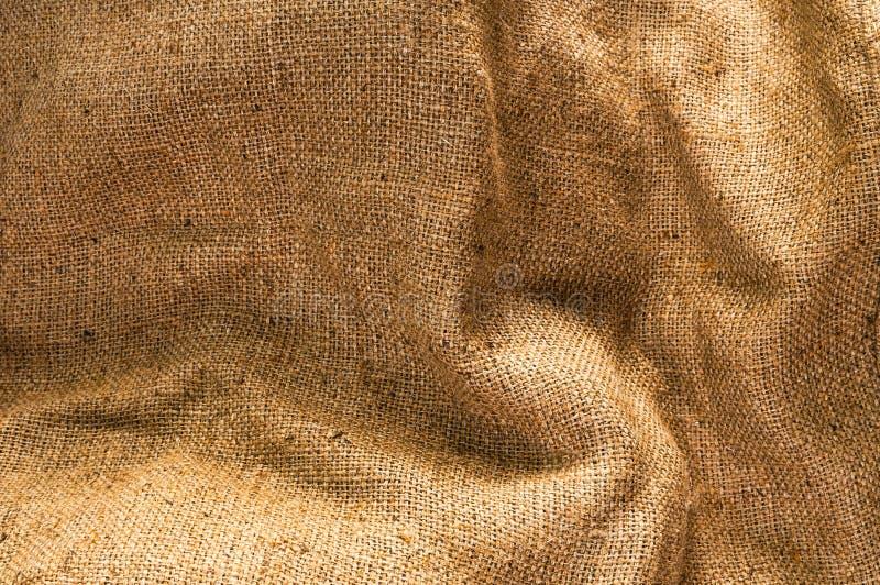 Vecchia tela, tela di sacco marrone, struttura beige d'annata del tessuto fotografie stock libere da diritti