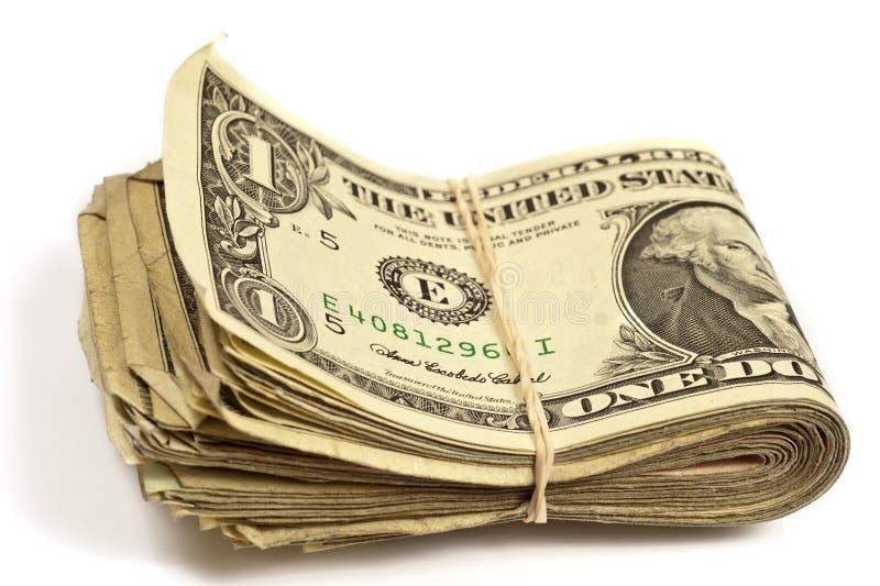 Vecchie banconote in dollari piegate con l'elastico fotografia stock