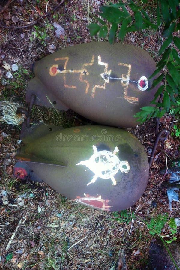 Vecchie bombe degli spazii in bianco per i pacifisti dipinti di un bombardamento di formazione fotografie stock libere da diritti