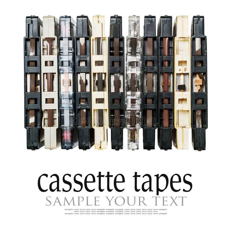 Vecchie ed audio cassette sporche isolate su bianco fotografie stock