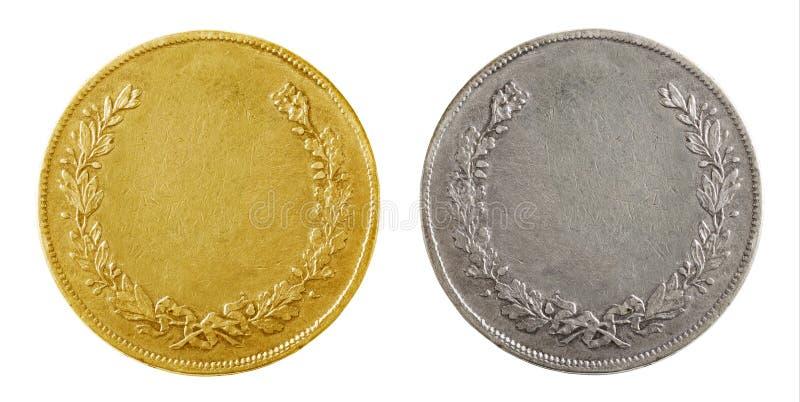 Vecchie monete in bianco immagini stock