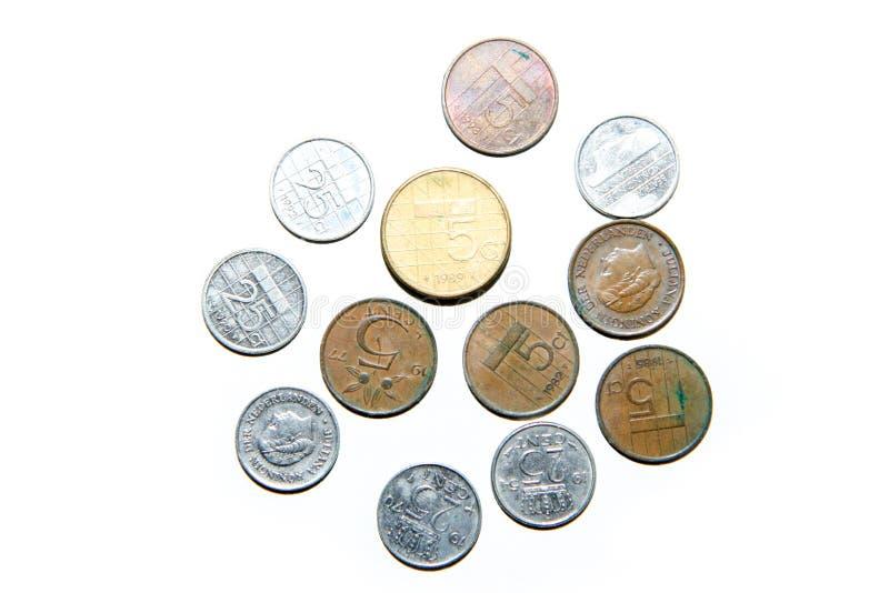Vecchie, monete invalide dai Paesi Bassi fotografie stock libere da diritti