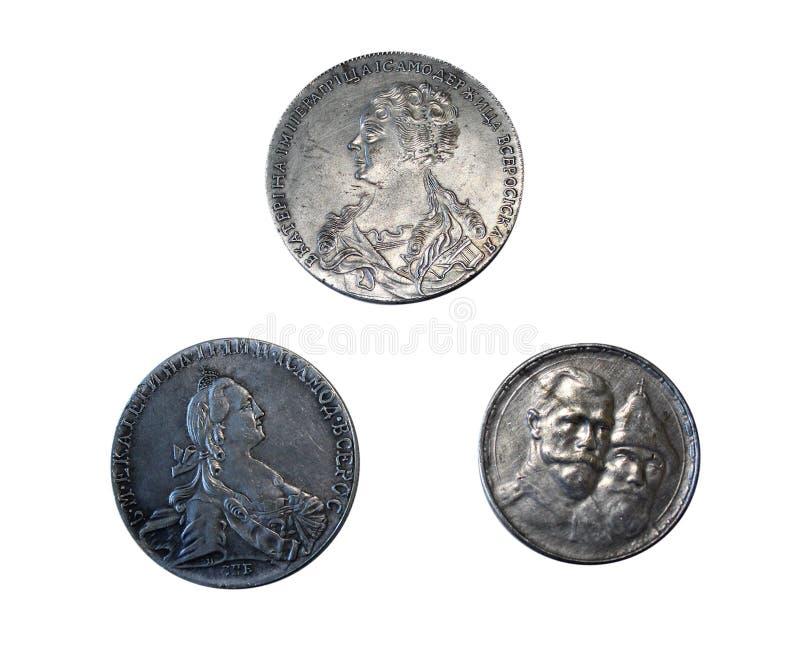 Vecchie monete russe isolate su fondo bianco fotografia stock