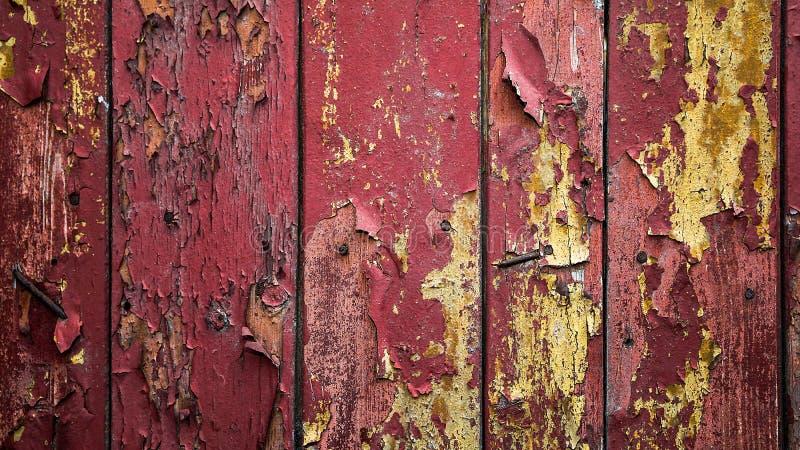 Vecchie plance di legno con la pittura della sbucciatura Pittura di sfaldamento Backgroun immagini stock