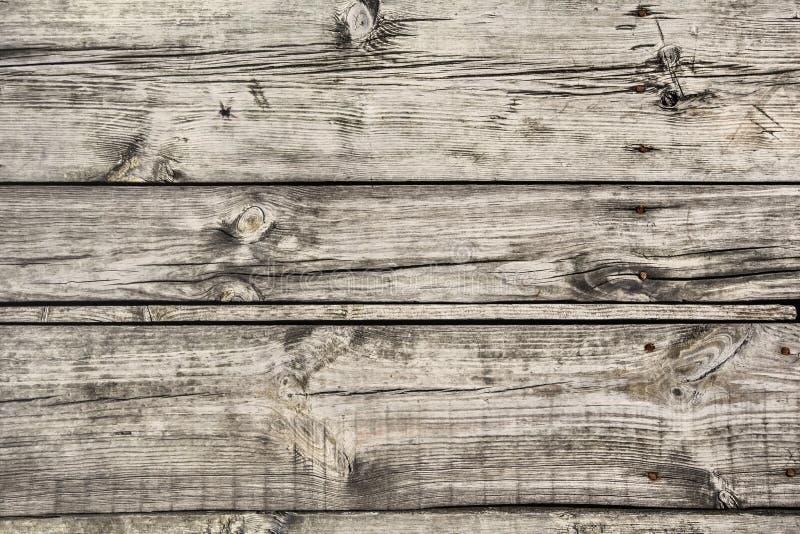 Vecchie tavole di pavimento annodate incrinate marcie stagionate Textur di superficie fotografia stock libera da diritti