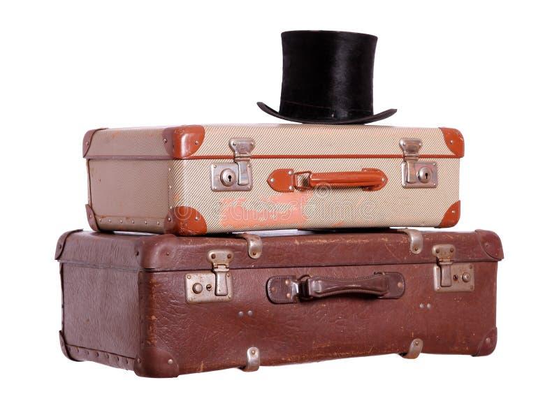 Vecchie valigie con black hat immagini stock
