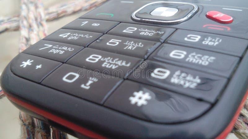 Vecchio bottone mobile immagine stock