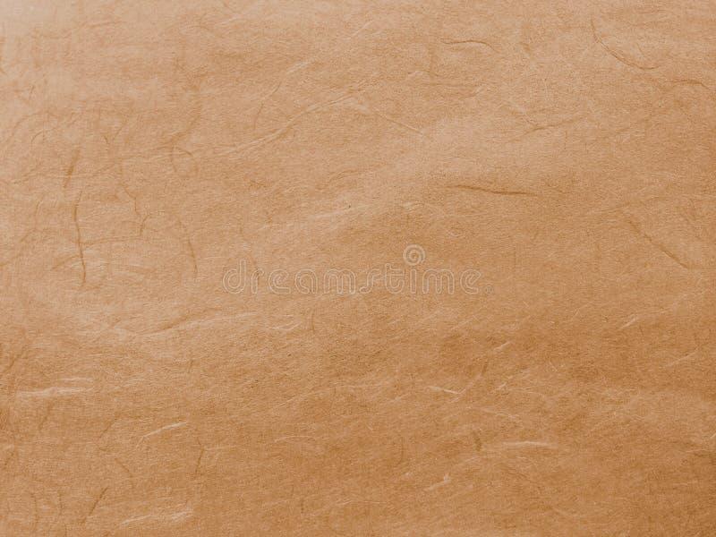 Vecchio Brown astratto ricicla il fondo di carta di struttura del gelso immagine stock