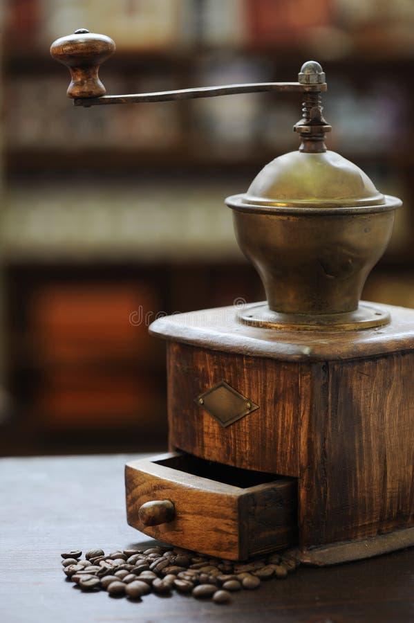 Vecchio caffè della smerigliatrice fotografia stock
