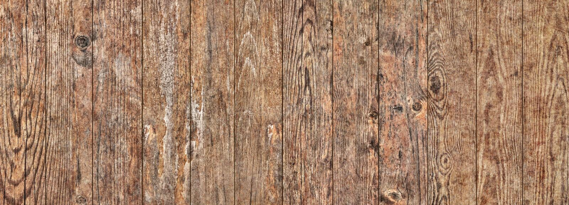Vecchio dettaglio annodato incrinato stagionato di struttura di lerciume delle tavole di pavimento di legno di pino fotografia stock