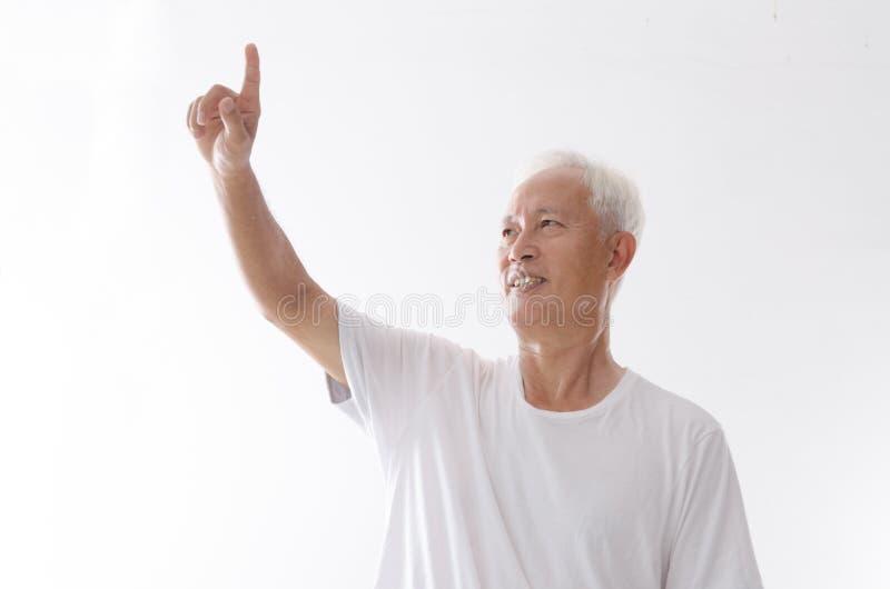 Vecchio dito asiatico dell'uomo che indica sullo spazio fotografie stock libere da diritti
