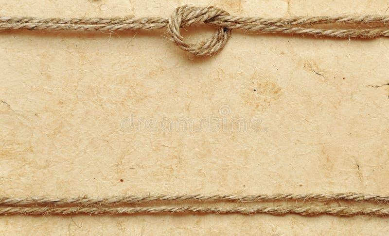 Vecchio documento con la corda fotografie stock libere da diritti