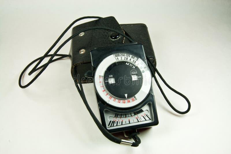 Vecchio esposimetro analog con il caso di cuoio immagini stock
