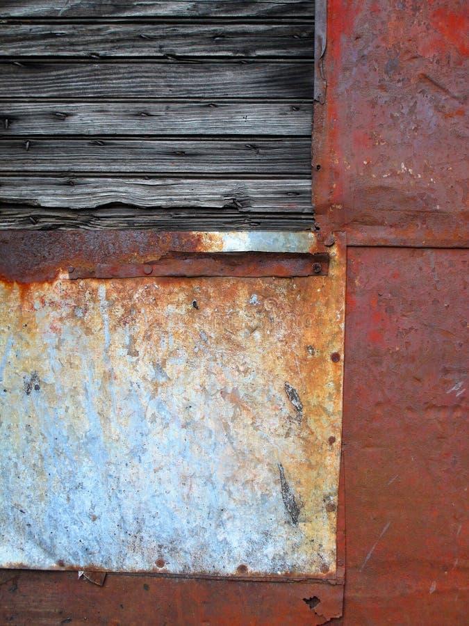 Vecchio estratto rattoppato del metallo immagini stock
