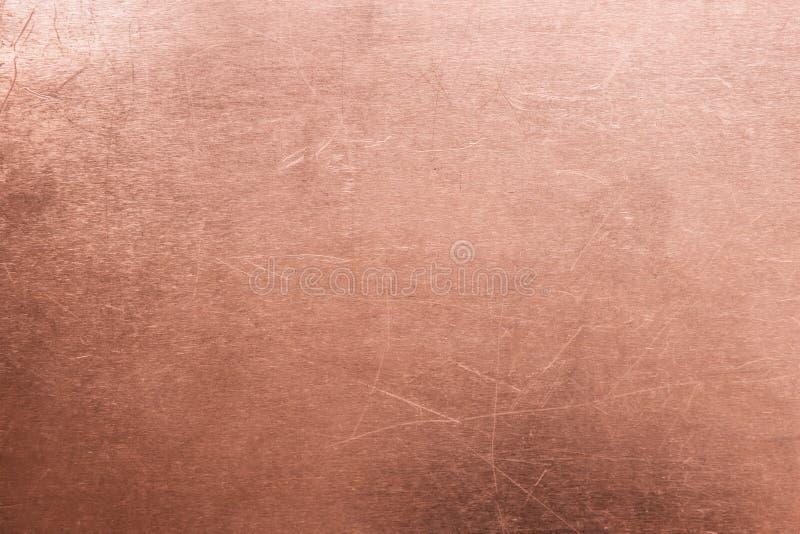 Vecchio fondo del rame o dell'ottone, struttura di un di piastra metallica arancio d'annata fotografia stock libera da diritti