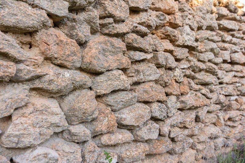 Vecchio fondo della parete di pietra E immagini stock