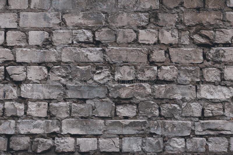 Vecchio fondo della parete di pietra Priorit? bassa del muro di mattoni Muro di cemento strutturato grigio Roccia ruvida di strut fotografia stock libera da diritti